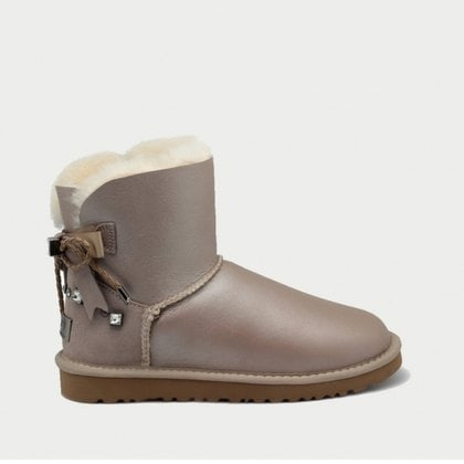Угги UGG Mini Bailey Bow Braid Metallic Sand